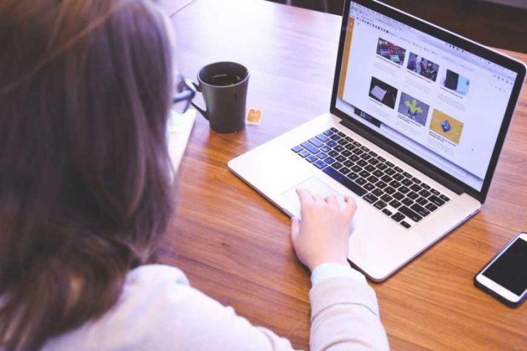 20150824164638 girl woman working macbook laptop computer technology office desk business